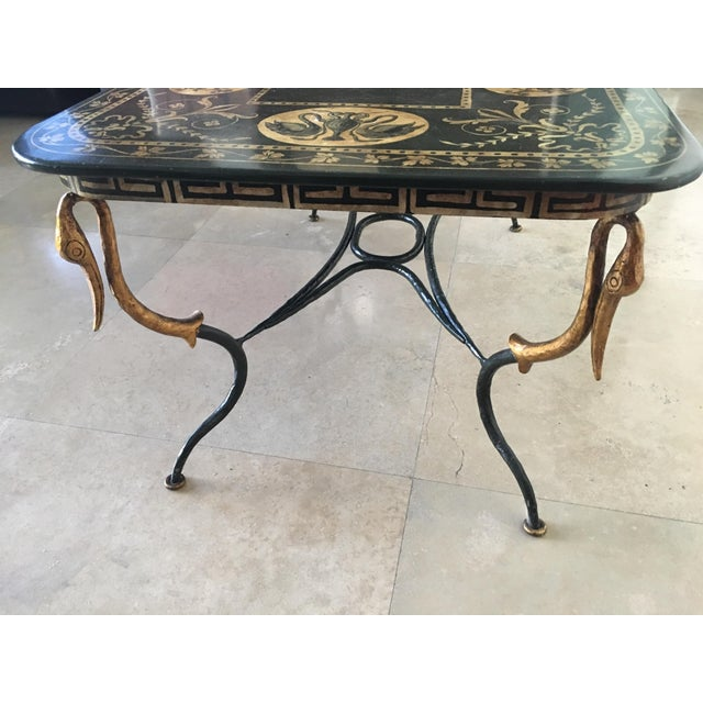 A rare piece with amazing design. Gold swan details on for corners. The top of the table is adorned with cherubs and...