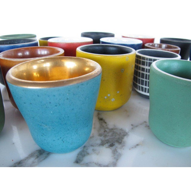 A fantastic collection of (18) ceramic cups by Waylande Gregory. Great colors and decoration.