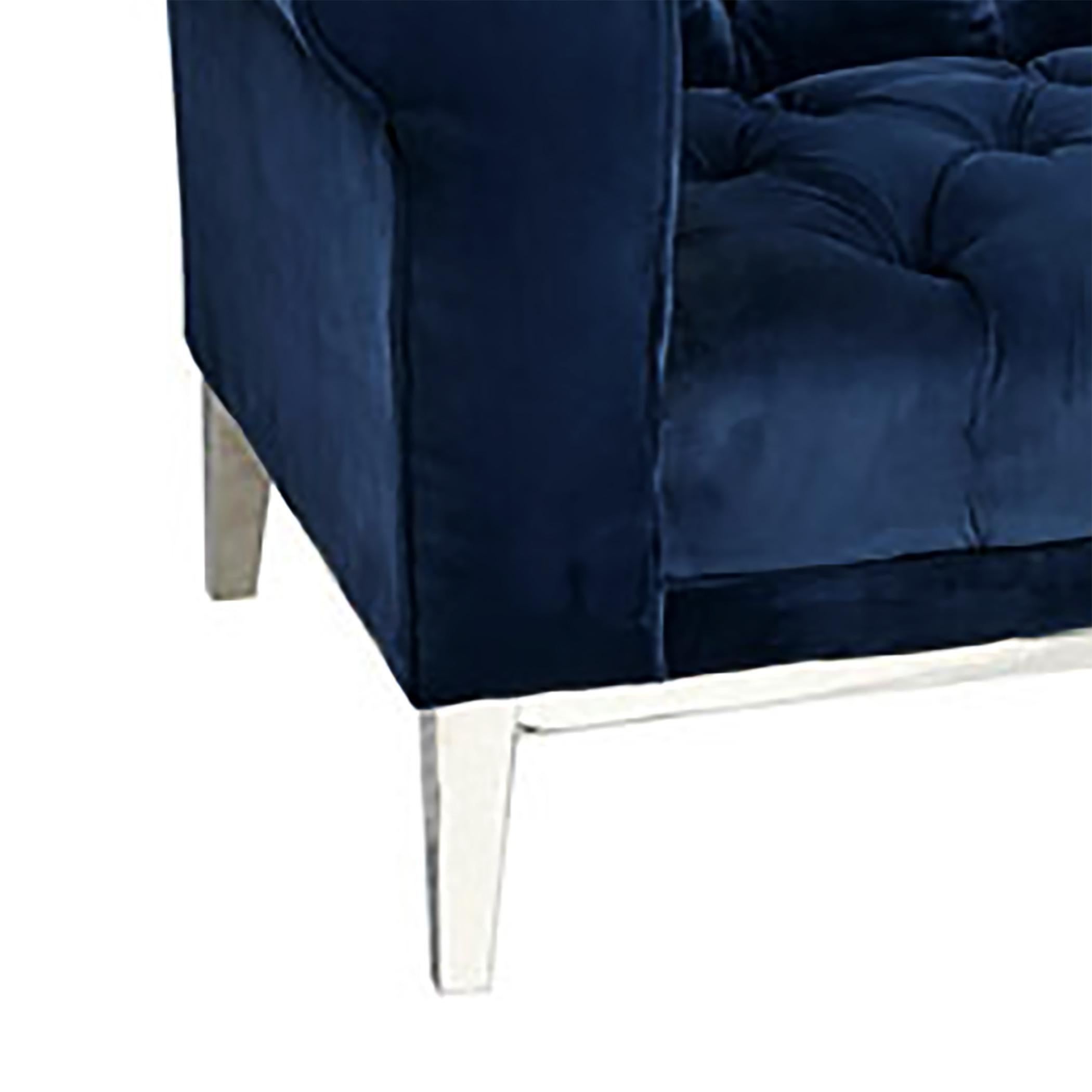 A Navy Blue Velvet Chesterfield Sofa Made Of Stainless Steel And Foam And Velvet  Fabric.