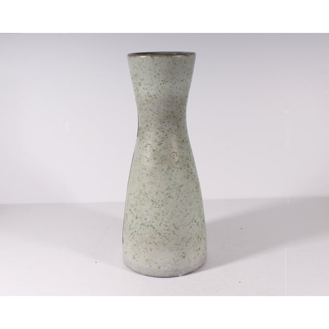 A Mid Century Modern vase by Swiss ceramist Philippe Lambercy (1919-2006). Made in Switzerland, the vase has a Cubist...