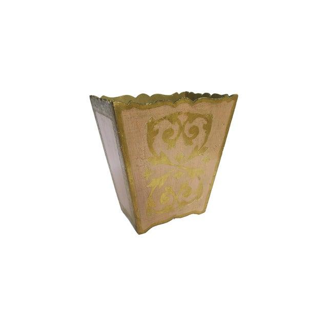 """Vintage Florentine waste basket/trash can. Light pink and gold gilt design. Measures 10"""" w x 8"""" d x 11 1/2"""" h. Has minor..."""