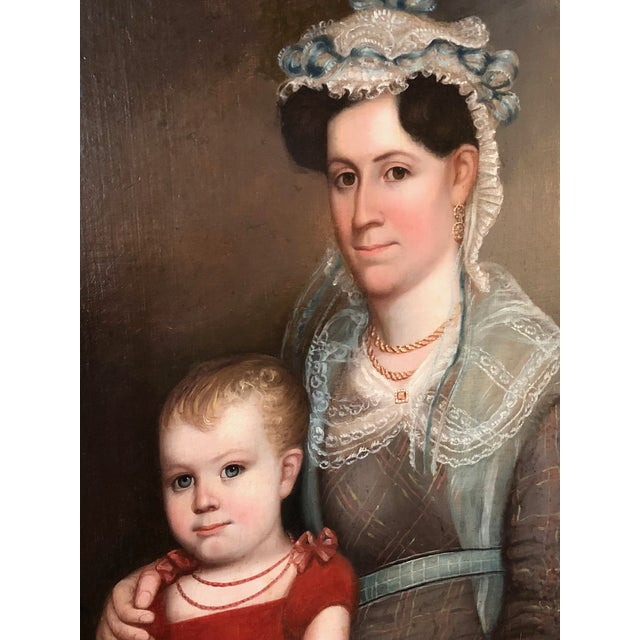 This finely painted itinerant American oil portraiture of a mother and child originated from an estate in Maine, USA and...