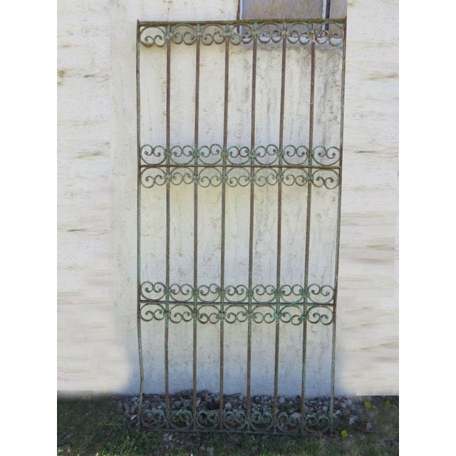 This iron gate is a wonderful piece of Architecture and heavy, tight, and sturdy. The piece does show signs of age related...