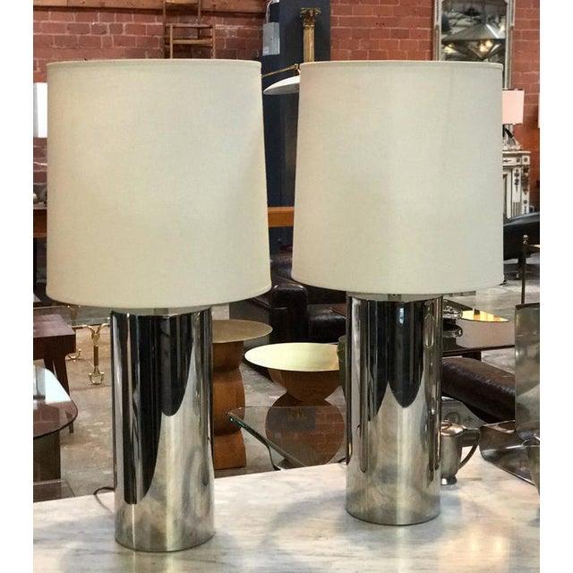 Steel cylindrical, saucy 1970s lighting. Rewire.