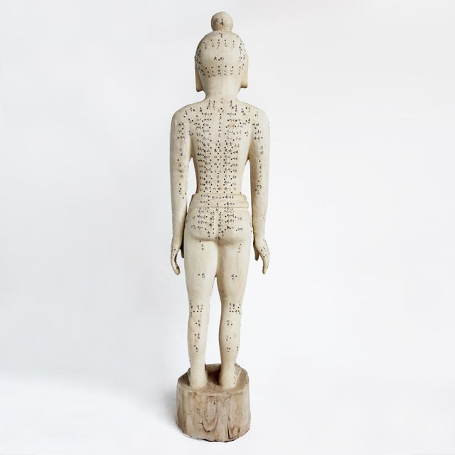 Chinese wood carved acupuncture teaching statue in X-Large size. Ink inscriptions cover the body showing notations of...