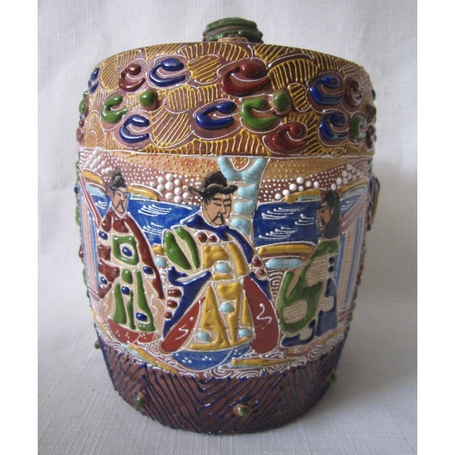 "Gorgeous Japanese Moriage-Satusma porcelain jar. Gorgeous colors and design with iconic images. It measures 8""H and 6""D..."