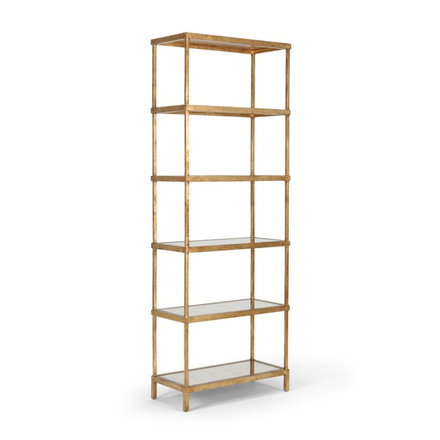 This is a gold etagere by Chelsea House Inc. The piece is made of iron, featuring an antique gold leaf finish and antique...