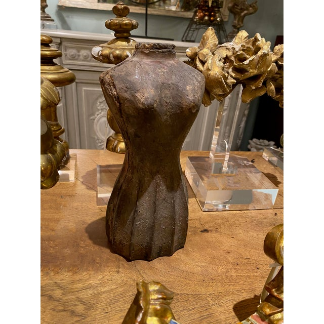 A lovely small table top size, shapely antique carved wood dress form from France. 19th century, antique.