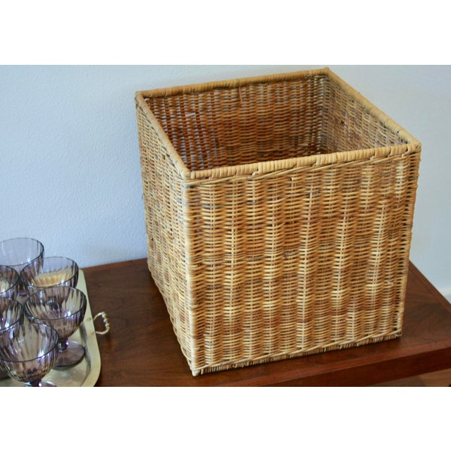 Love organic textures, but don't want to dive too far down the bohemian rabbit hole? This cube-form structured wicker box...
