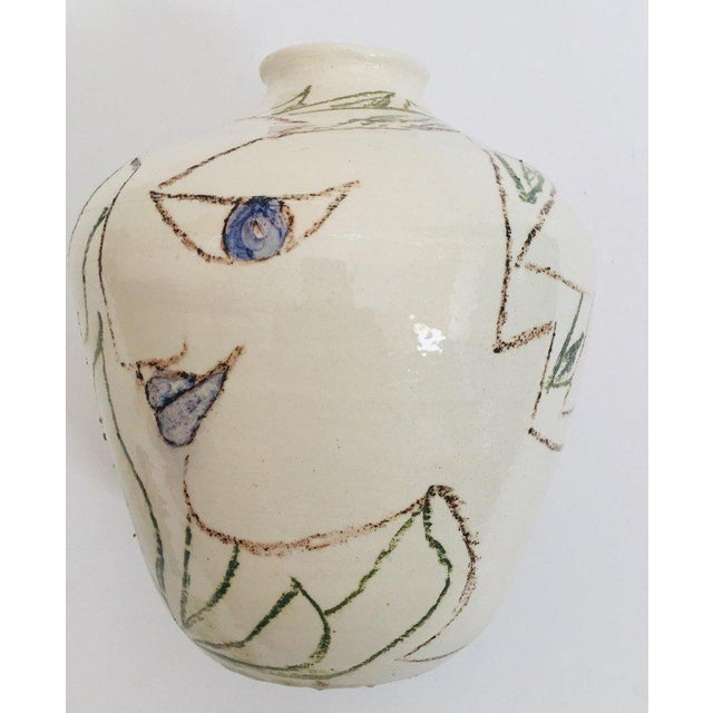 I am totally in love with this postmodern vase with abstract head portraits figures in Jean Cocteau style, the Taureaux....