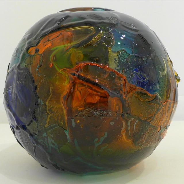 Glass vase comprised of multiple layers of colored glass built over a clear spherical matrix. Designed by Gae Aulenti and...