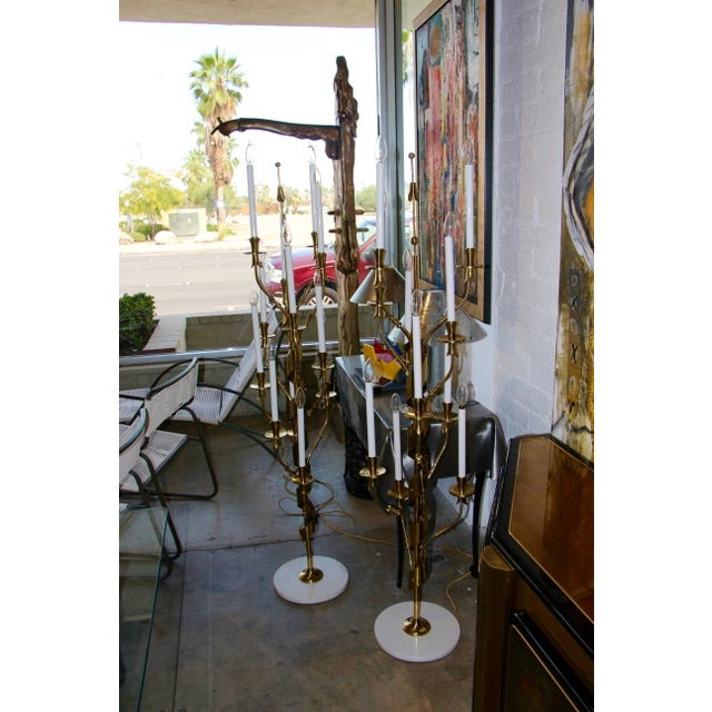 A stunning pair of Stilnovo candelabra brass floor lamps in working order with marble bases. These likely date to the...