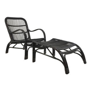 Asian Modern Black Rattan Chair and Footstool Set of Two For Sale