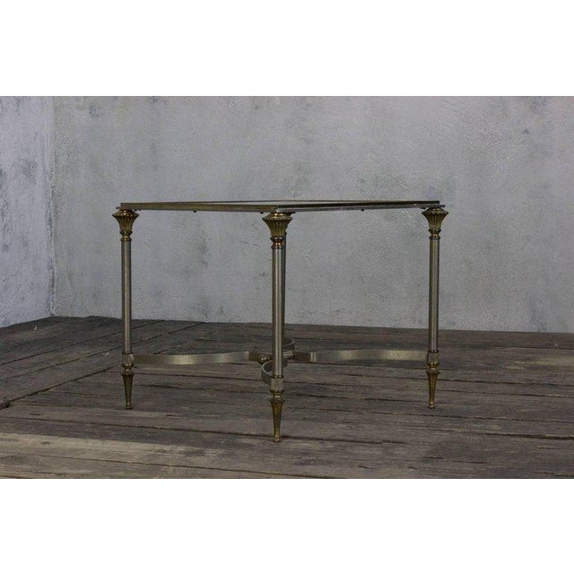 Elegant Italian end table with steel and brass components. The top is inset glass, circa 1940s.