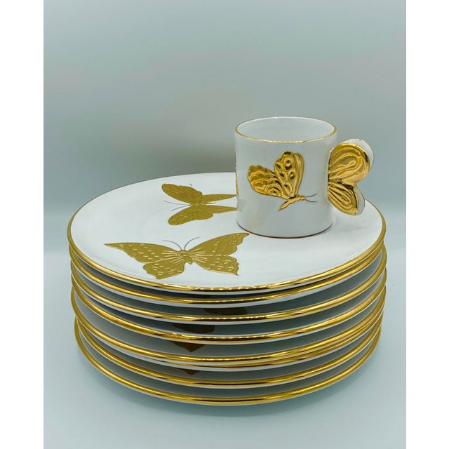 Incredible set of Carole Stupell luncheon plates. 8 plates with matching cup. Beautiful golden butterfly design on each...