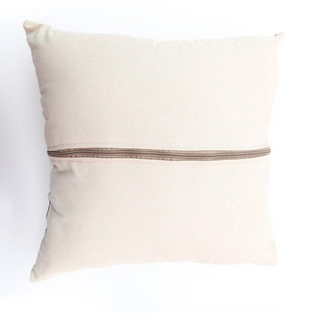 Luxuriate in comfort and style with these two sumptuous square-shaped Rabati throw pillows featuring a beautiful hand-sewn...