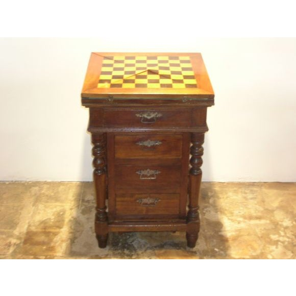 A four drawer game table from the 1900s in very good, antique condition.