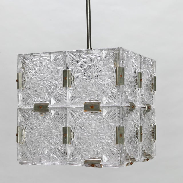 Cube shaped suspended cube light, circa 1970s made of clear molded glass panels and nickel metal joiners in the style of...
