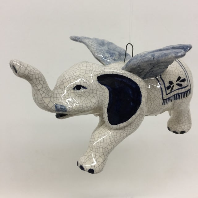 This lovely flying elephant will make you smile. He can hang from a string anywhere you desire or he can sit on a shelf...