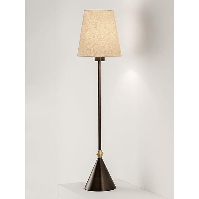 Taller slender lamp with shade in black bronze with English brass. Suitable for use on narrow consoles, side tables and...