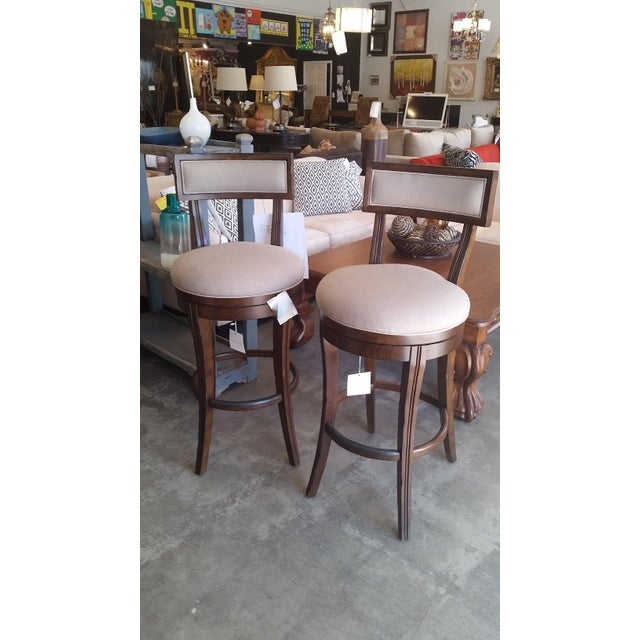 This listing is for a set of two Caracole brand swivel bar stools in taupe fabric. They are in excellent condition, the...
