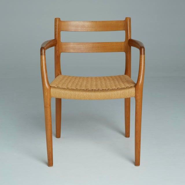 This pair of Danish modern model 67 chairs, designed by Niels O. Møller, is one of J.L. Møller's landmark designs. The...
