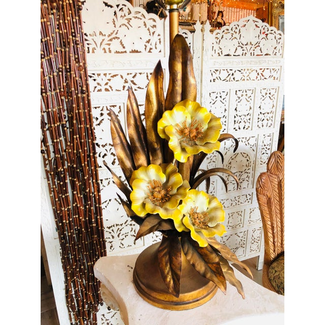 Fantastic vintage tole lamp made in Italy. With beautiful bright yellow flowers. In fantasy vintage condition. Finial and...