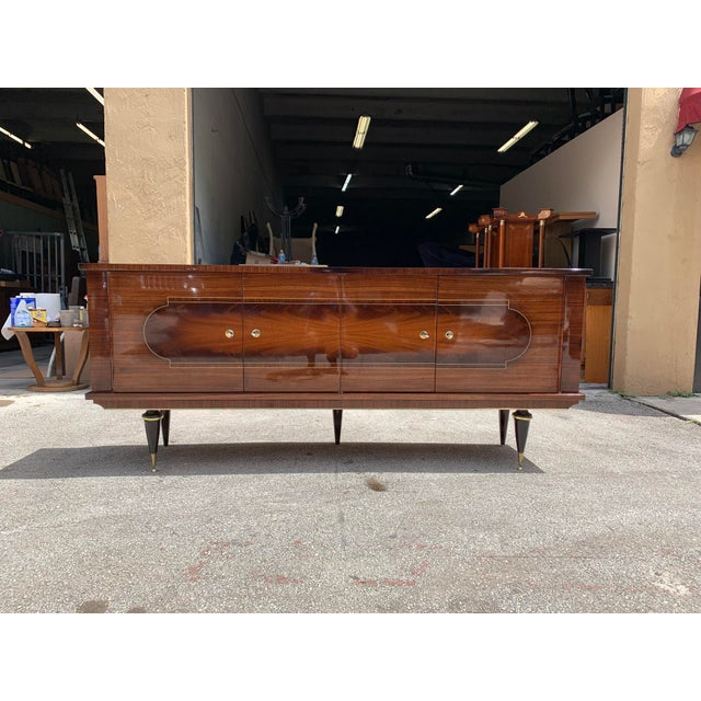 Monumental French Art Deco exotic Macassar ebony sideboard or buffet, circa 1940s. This piece displays very high levels of...