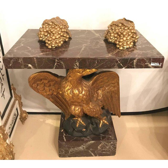 A large gilded eagle marble-top and base console or pedestal table. Federal style giltwood carved eagle pedestal table....