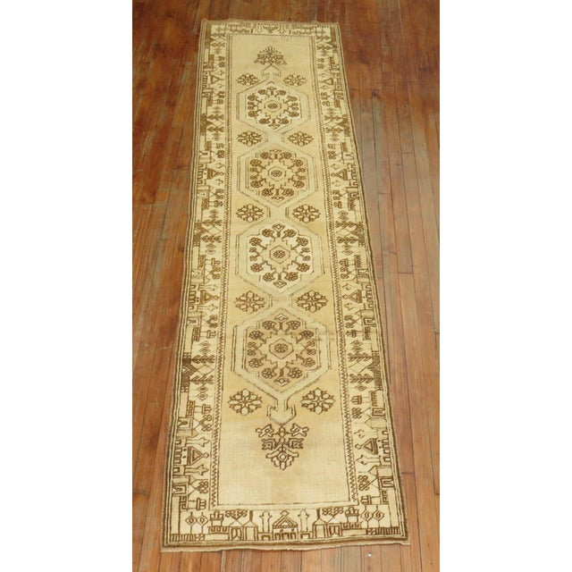 One of a kind vintage Turkish hand-woven runner in creamy yellow and brown accents. The border has an interesting...