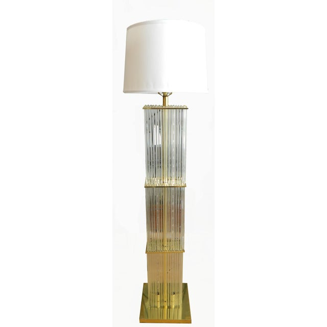 Elegant brass floor lamp with 144 glass rods and two center LED lights that illuminate the rods. Wired for US use and in...