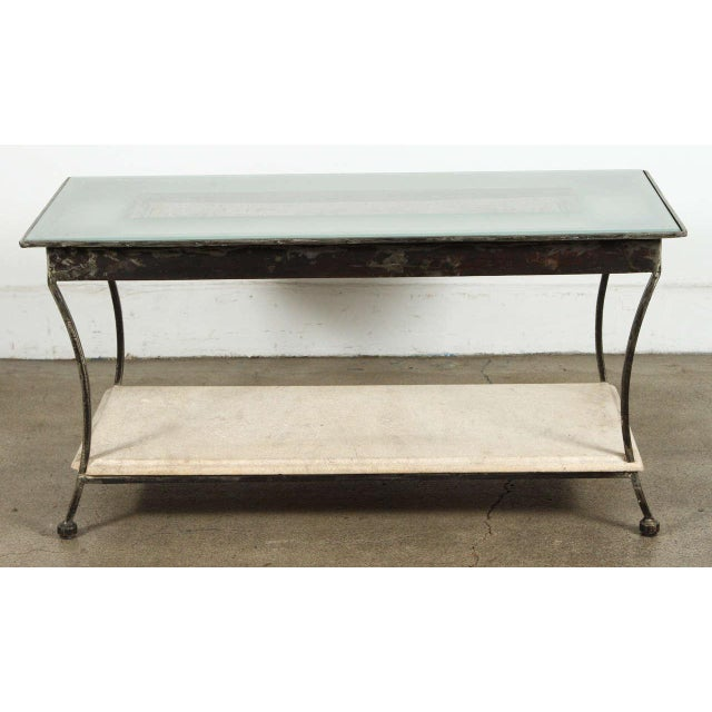 Carved stone outstanding Asian architectural relief made into a side or coffee table. Wrought iron stand with cement base...
