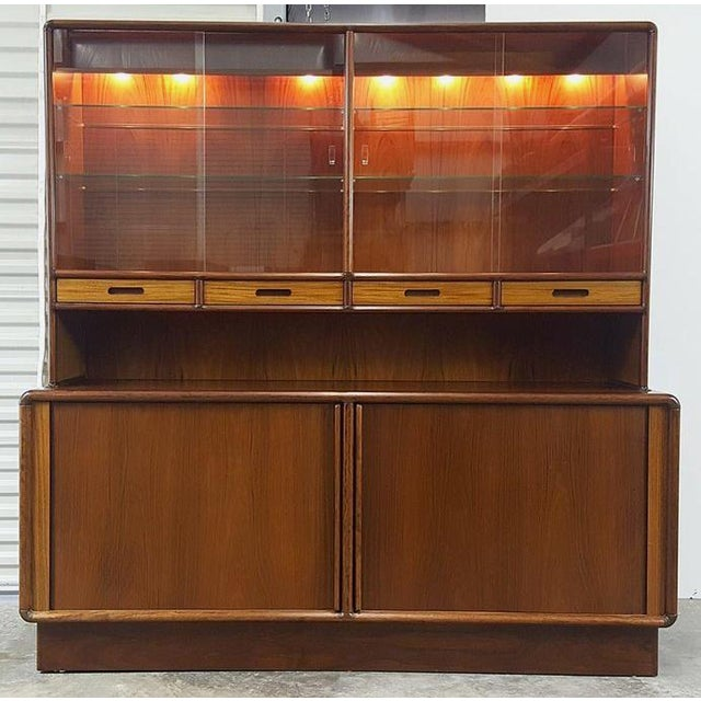 Beautiful Lighted, Danish rosewood cabinet, interior drawers, exterior drawers, shelves, ample storage. Top has glass...