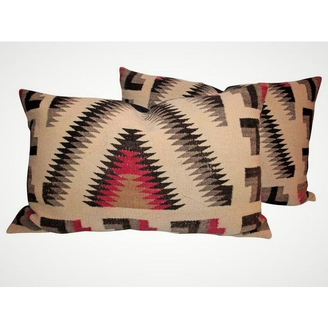These Navajo Indian weaving bolster pillows are in fantastic condition with a double sawtooth pattern running throughout....