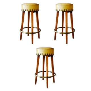 Mid-Century Yellow Bar Stools With Round Brass Footrest, Set of Three For Sale