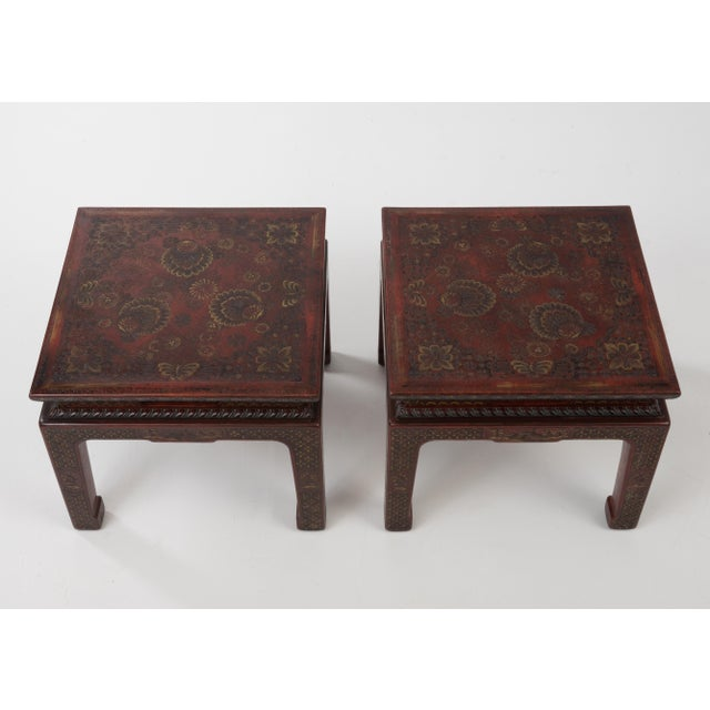 A gorgeous textured encised gesso over wood pair of end or side tables in a deep burgundy with intricate floral and...