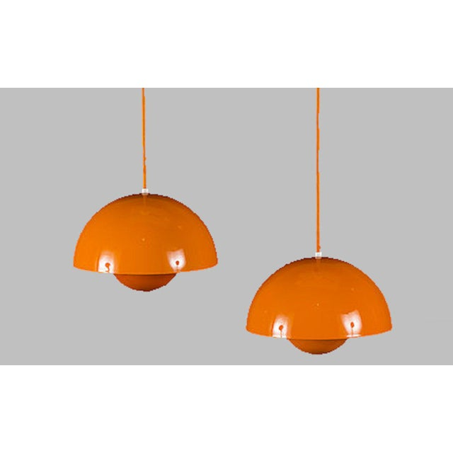 Verner Panton enamel flowerpot pendant lights designed for Louis Poulsen in 1969. This set of two orange/yellow pendant...