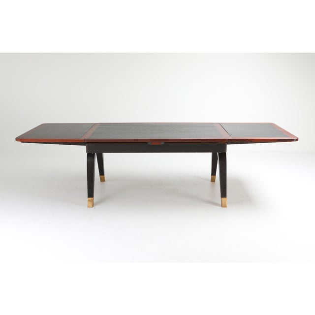 Mahogany and brass Art Deco dining table which was custom designed for a castle in Ghent Belgium. Two extensions make the...