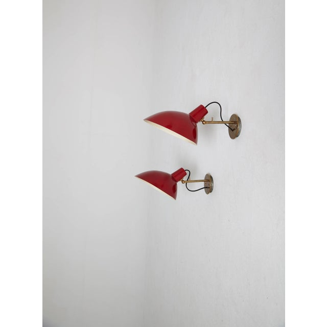 A pair of Visor wall sconces/lights designed by Vittoriano Vigano for Arteluce, Italy.