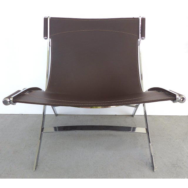 Offered for sale is a pair of Scissor chairs widely known as being designed by Paul Tuttle and manufactured by Flexform...