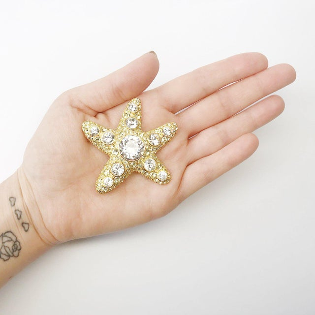 Under the sea there is a wonderful starfish by KENNETH JAY LANE. This collectible piece is one of a kind with its citrine...