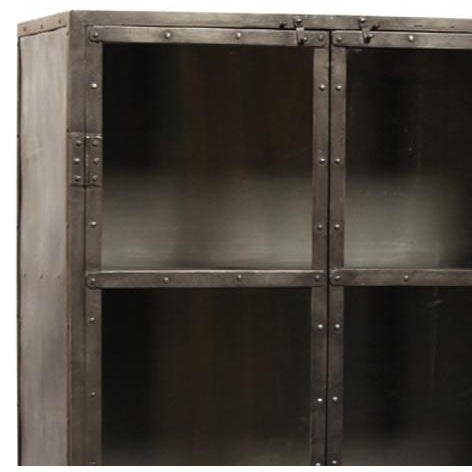 Industrial gunmetal iron storage cabinet with glass panels in top half of doors and three fixed shelves inside. Each is...