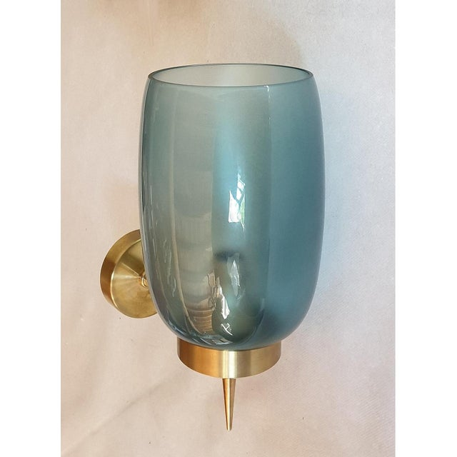 Pair of blue/green translucent Murano glass Mid-Century Modern sconces, attributed to Seguso, 1970s. Brass mounts. 1-light...