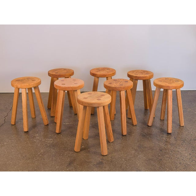We have 8, four-legged American Craft stools constructed from warm, natural oak. In the style of Charlotte Perriand....