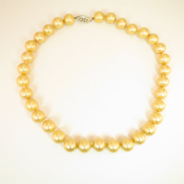 Offered here is a substantial necklace of faux South Seas pearls from the 1940s. These large 12mm glass pearls are hand-...