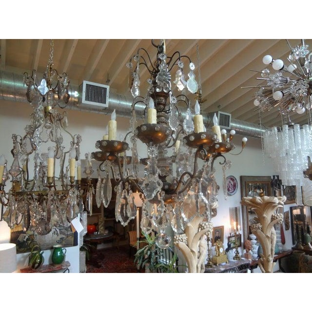 Unusual French Maison Baguès attributed Louis XVI style bronze and wood beaded and crystal chandelier. This stunning...