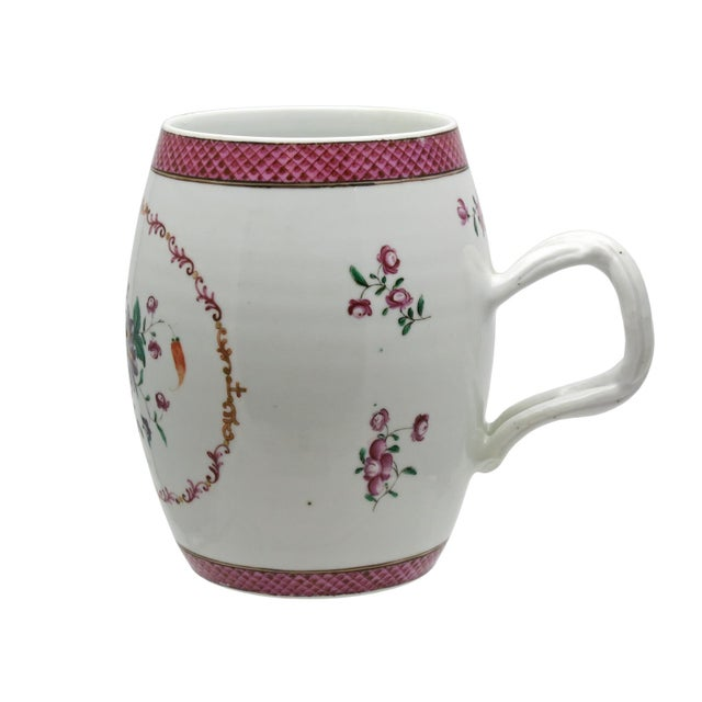 A fine late 18th century Chinese export handled cup or small tankard. The piece is barrel shaped with a double strapped...