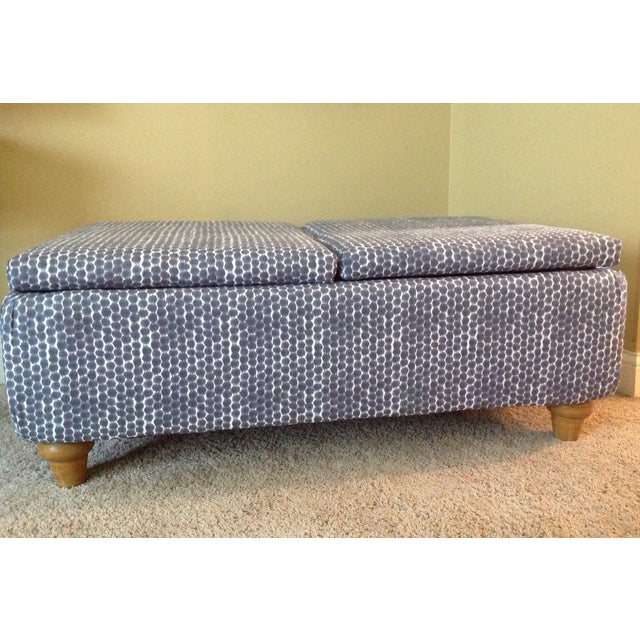 This classic navy Ikat storage ottoman features a new foam pad, batting, interior and exterior fabrics. It has a deep...