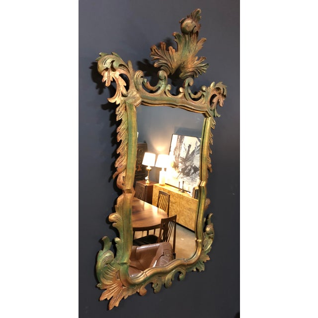 Beautiful hand carved piece. Green undertone throughout mirror adding detail and color variation.