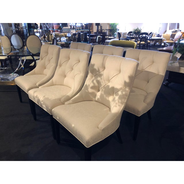 Beautiful set of six light-weight, comfortable dining chairs from Swaim Furniture. Textured white fabric, black wood legs....